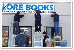 Valore Books team putting up sign